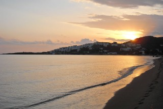 location irini tinos laouti beach sunset
